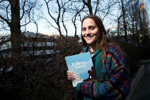 Author Lára Garðarsdóttir with her book, titled Bear with me in English, about a couple of polar bears forced to flee their home.