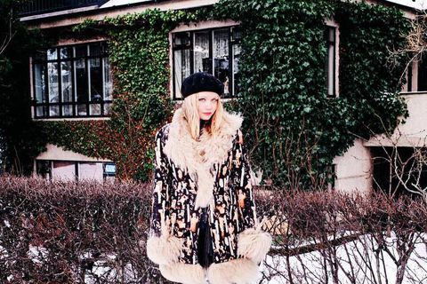 Photographer Saga Sigurðardóttir always looks impeccable whatever the weather. Here she wears a wool and Mongolian lambskin coat by Icelandic designer Hildur Yeoman.