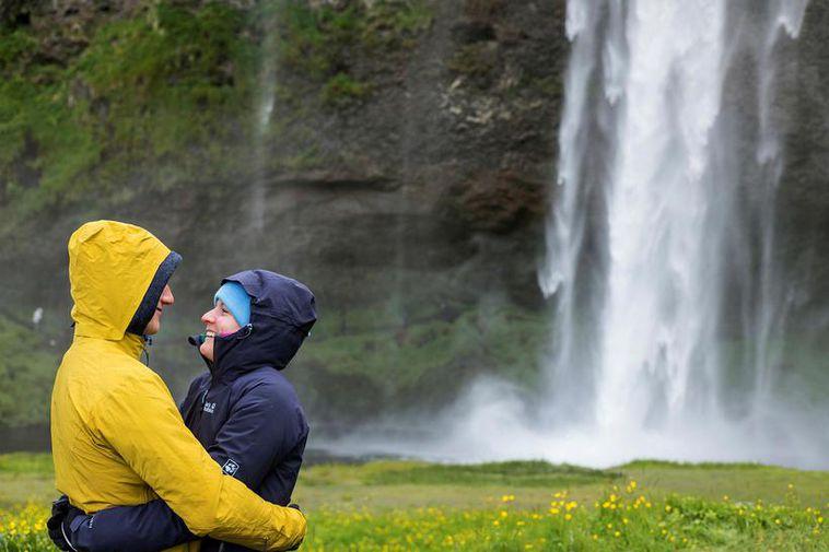 Tourists at Seljalandsfoss waterfall.