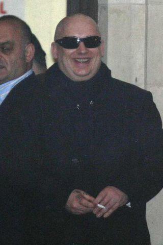 Boy George sést hér yfigefa dómshúsið í London í síðustu ...