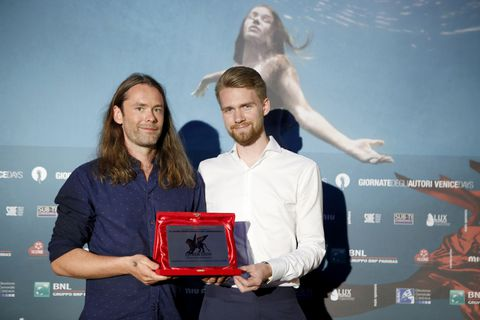 Director Guðmundur Arnar Guðmundsson (left) and producer Anton Máni Svansson (right) receiving their award.