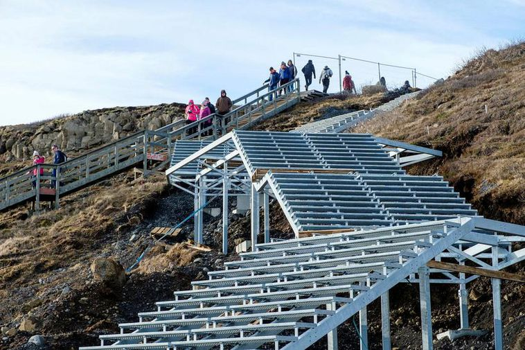 The new stairs will be ready by the end of next month.