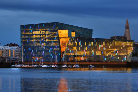 The hotel will be built in the building site to the right of Harpa in this photograph.
