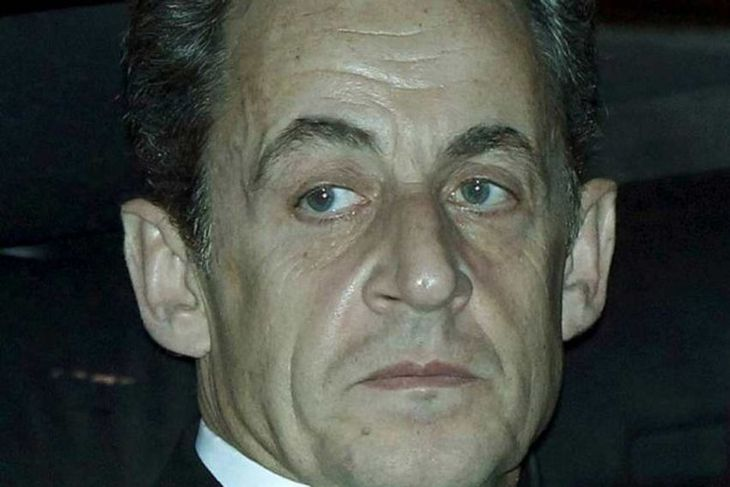 France's President Nicolas Sarkozy arrives at an European Union summit in Brussels December 8, 2011. ...