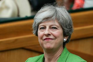 Theresa May, forsætisráðherra Bretlands, sagði þingmönnum flokksins að fara í almennilegt sumarfrí og koma svo ...