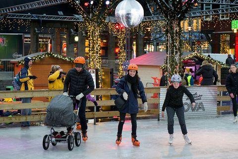 Families enjoying the ice skating rink last year.
