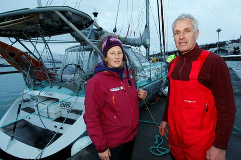 Dario Schwoerer and Sabine by the sailboat Pachamama, their home for 17 years. They got in danger during the storm.