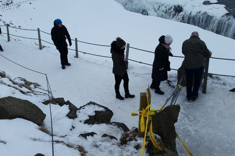 The photographs show tourists removing police tape and crossing the barrier and warning signs at Gullfoss waterfall.