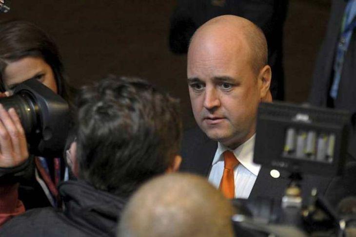 Sweden's Prime Minister Fredrik Reinfeldt (R) arrives at an European Union summit in Brussels December ...