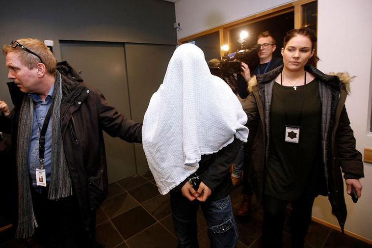 Police with one of the suspects in the case of missing woman Birna Brjánsdóttir.