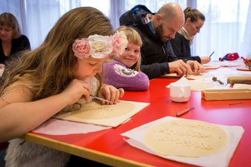 Children and adults alike love the art of leaf bread making.