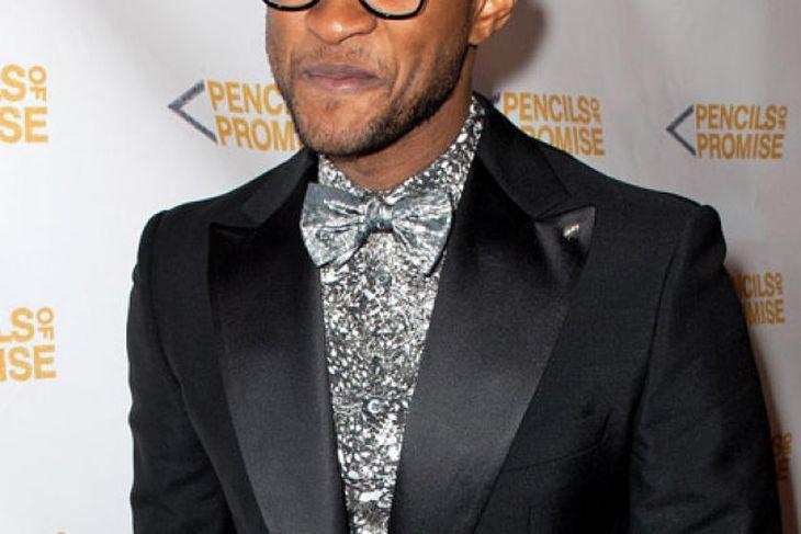 Usher stendur í forræðisdeilu.