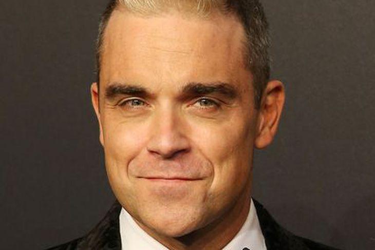 Robbie Williams er að gefa út ævisögu sína.