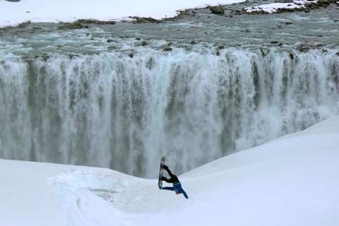 Snowboarding in front of Iceland's most powerful waterfall, Dettifoss.
