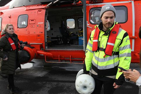Ásgeir Trausti with the bottle, getting ready to board the helicopter.