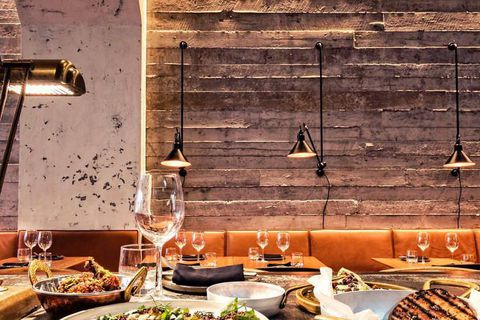 Sumac's interiors are designed by Halfdan Pedersen and juxtapose raw concrete walls with warm leather furnishings.
