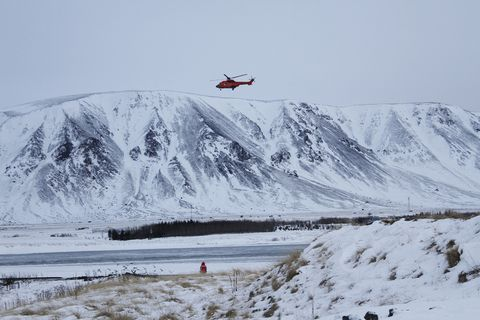 The national coastguard helicopter at work yesterday searching for a missing man in the Ölfusá river. The day was an arduous one for its crew.