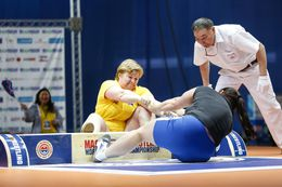 Two times Iceland's strongest woman, Þóra Þorsteinsdóttir wrestles with her opponent from Kyrgyztan, with Maria ...