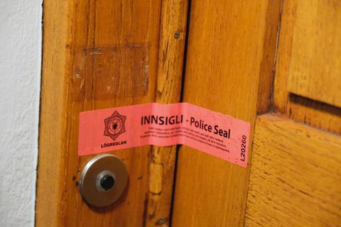 Police sealed the entrance to the assistant professor's home.