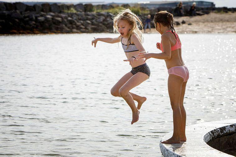 Icelandic children playing at Nauthólsvík geothermal beach.