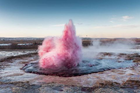 The geysir Strokkur as you've never seen it before: a bright shade of pink.