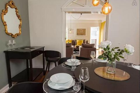 The dining room has original features and trendy grey walls.
