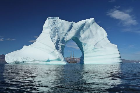 Scooner the Opal can be seen here in the middle of the astonishing iceberg.