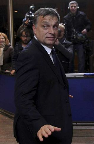 Hungary's Prime Minister Viktor Orban arrives at an European Union summit in Brussels December 8, ...