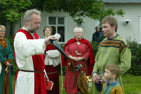 High Chieftain Hilmar Örn Hilmarsson on the left at an Ásatrú ceremony.