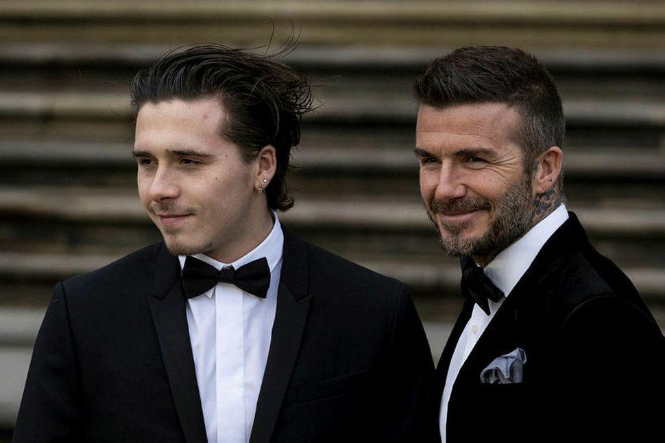 Brooklyn Beckham ásamt föður sínum David Beckham.
