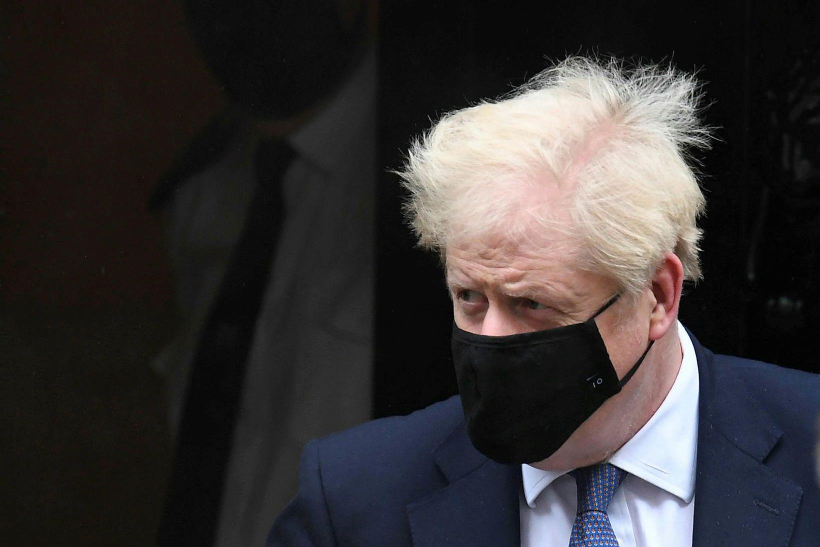 Boris Johnson, forsætisráðherra Bretlands, grímuklæddur.