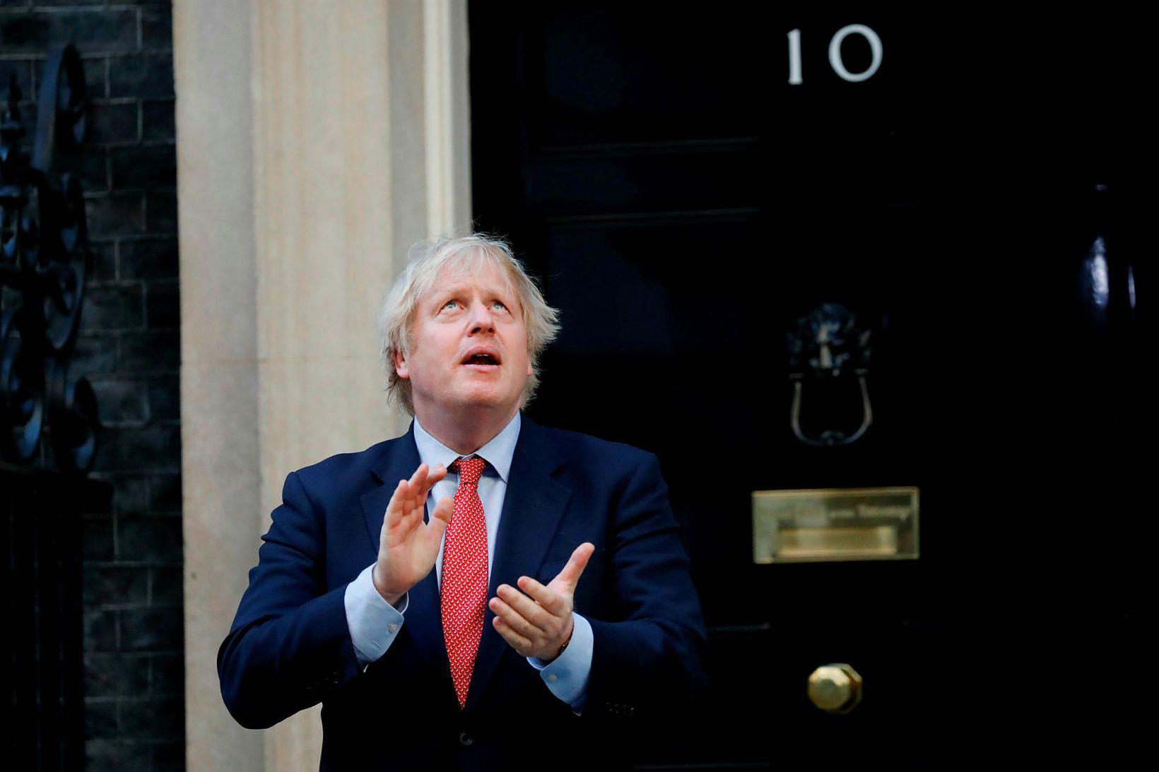 Boris Johnson forsætisráðherra Bretlands ætlar að bretta upp ermarnar og …