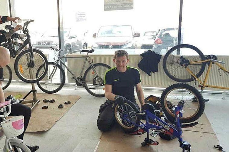 Volunteers at work, restoring bikes.