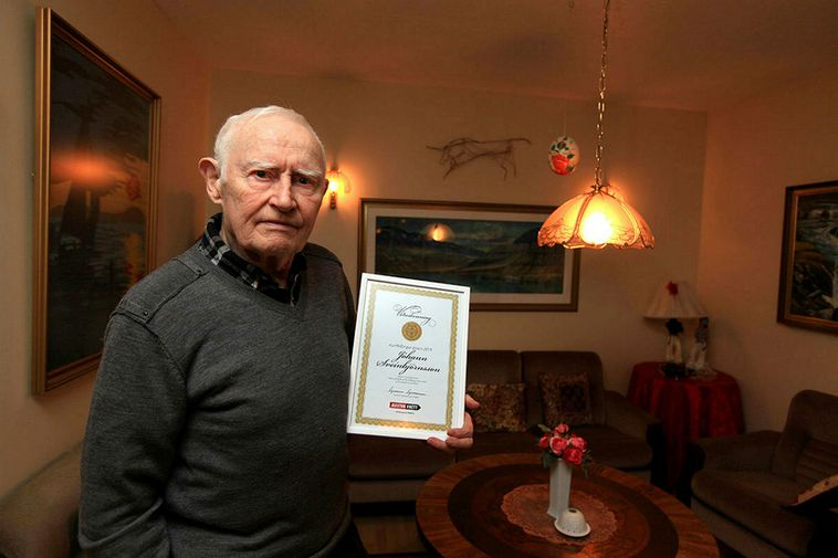 Jóhann Sveinbjörnsson, holding the certificate for being person of the year in the East Fjords.