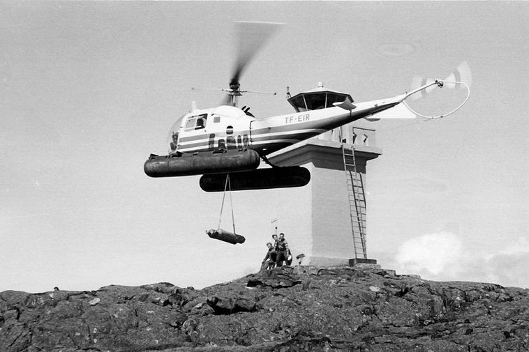 TF-EIR, the first ICG helicopter from 1965, by an Icelandic lighthouse.