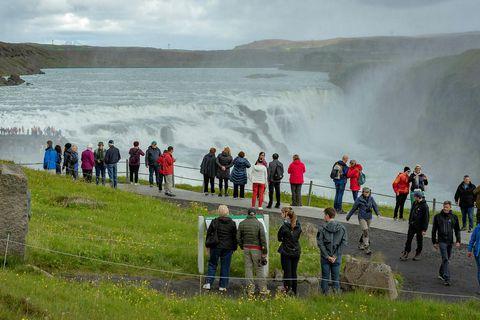 Tourists by Gullfoss waterfall.