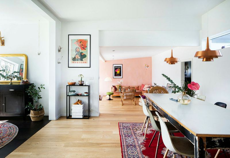 The Flamongo pink wall adds a touch of warmth.