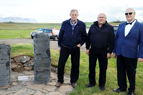 The present brothers from Reynistaður, from left, Steinn, Helgi and Jón Sigurðsson, standing beside the memorial.