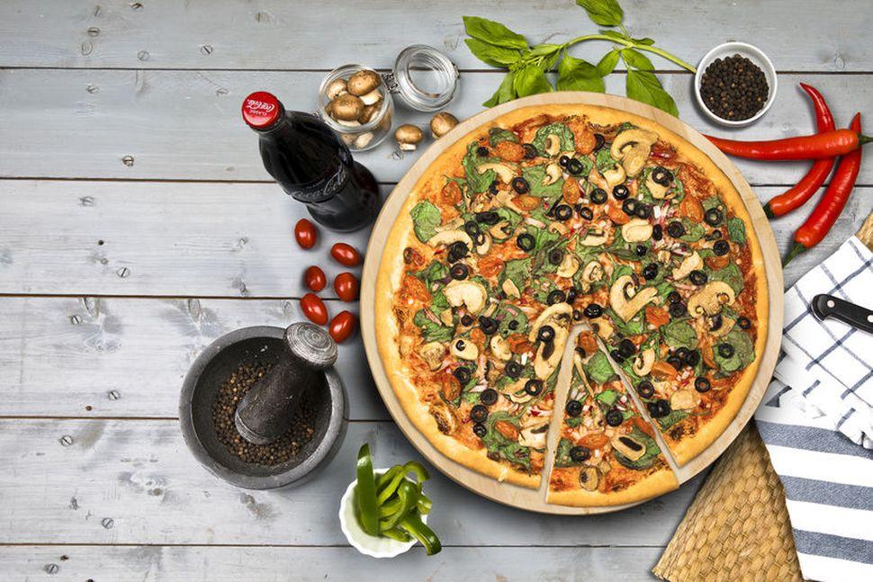 Domino's Pizza Group eignaðist allt hlutafé í rekstrarfélagi Domino's á ...