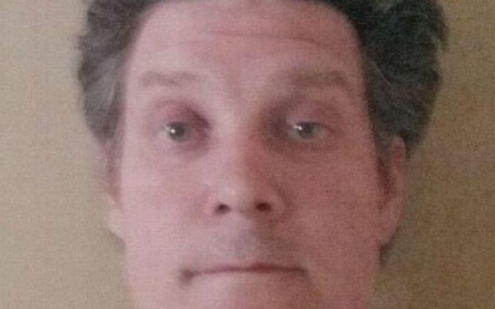 Jonathan Dick, 41 árs, var handtekinn í dag eftir rúmlega ...