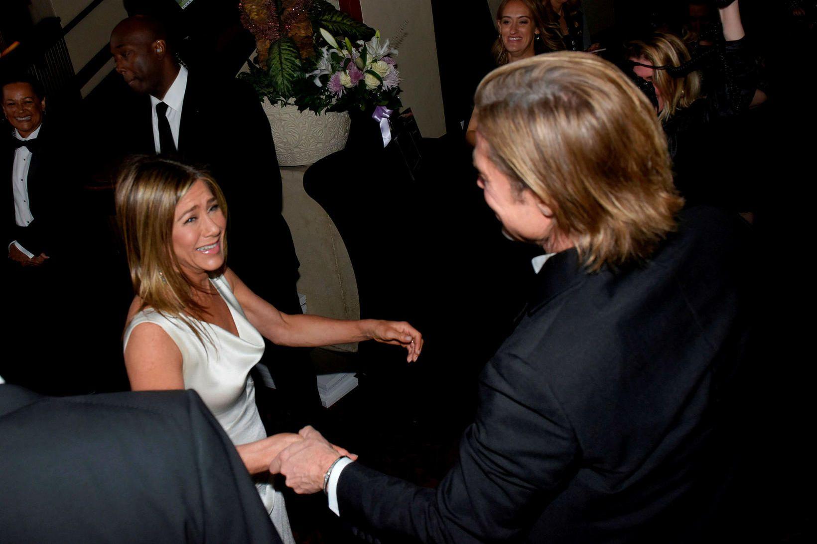 Jennifer Aniston og Brad Pitt voru glöð þegar þau hittust …