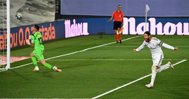 Sergio Ramos fagnar sigurmarki úr vítaspyrnu gegn Getafe.