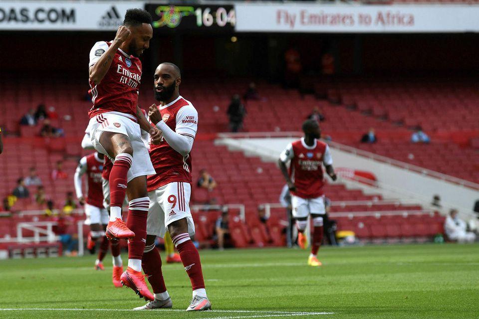 Pierre-Emerick Aubameyang fagnar einu af mörkum sínum gegn Watford á Emirates í dag.