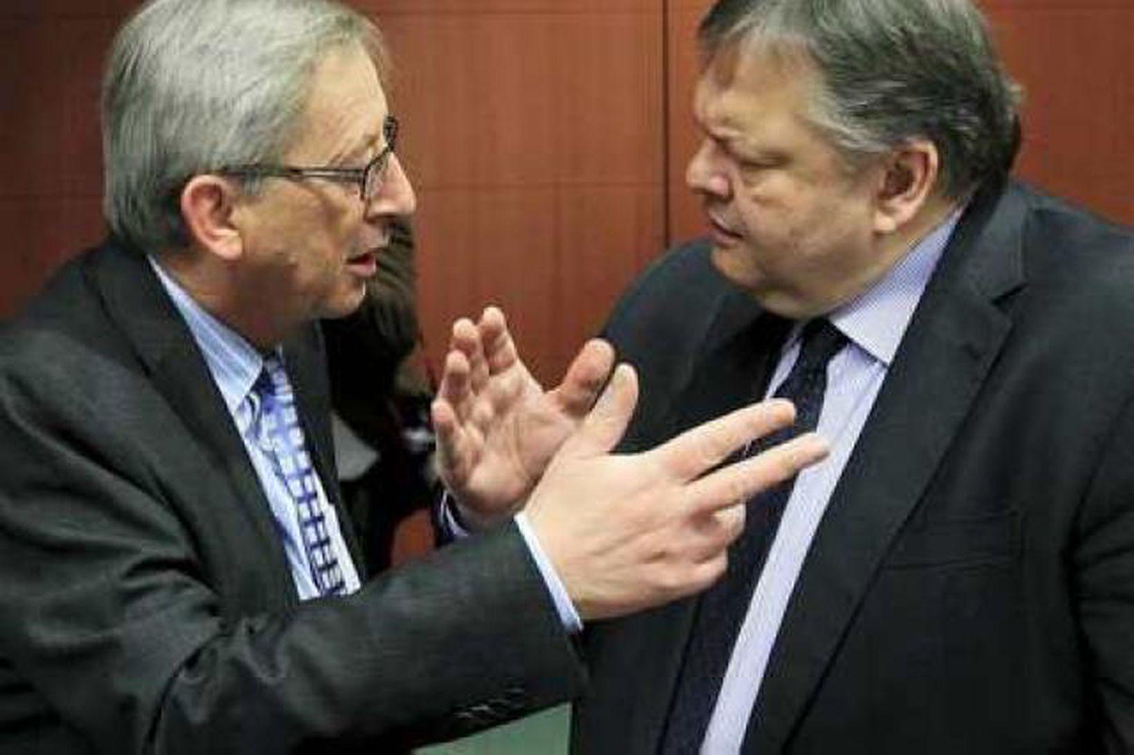 Jean-Claude Juncker og Evangelos Venizelos, fjármálaráðherra Grikklands ræða saman.
