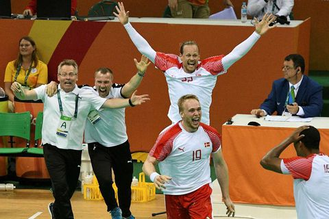 Guðmundur Guðmundsson (left) and the Danish players celebrating their victory.