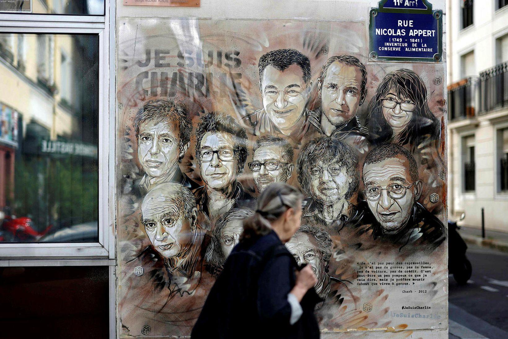 Málverk eftir Christian Guemy í París sýnir starfsmenn Charlie Hebdo …