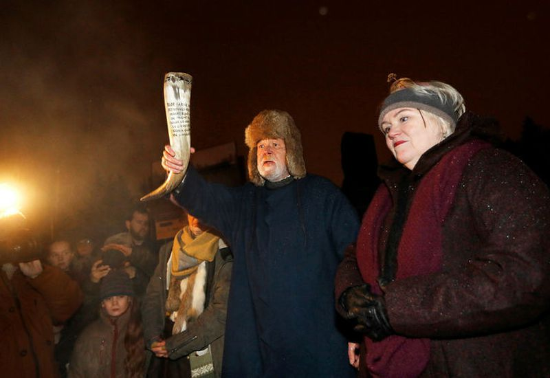 Hilmar Örn Hilmarsson carrying a drinking horn at the Winter Solstice ceremony last night.