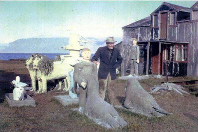 Samúel Jónsson photographed in his garden of sculptures in 1965.