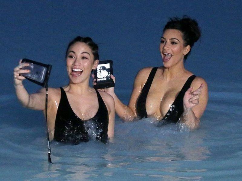Stephanie Sheppard and Kim Kardashian having fun taking selfies in the Blue Lagoon.