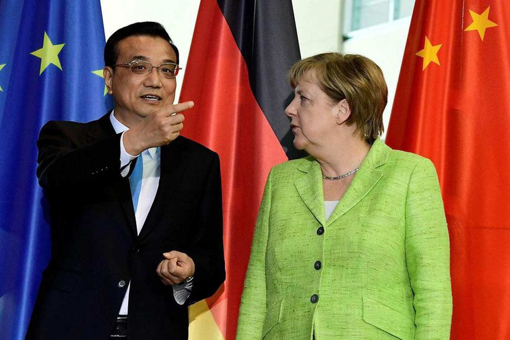 Li Keqiang, forsætisráðherra Kína, og Angela Merkel, kanslari Þýskalands, hittust …